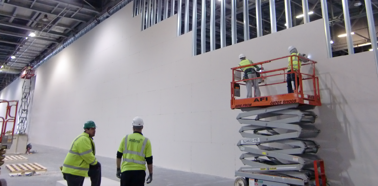 Large banner image showing the London Olympics 2012 Partition Wall being installed.